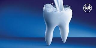 dente sendo preenchido por leite