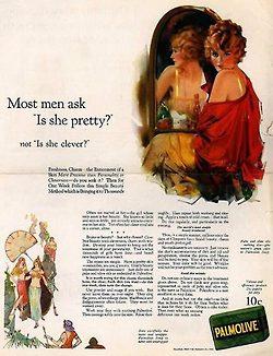 Anúncio de Palmolive. Mulher à frente do espelho, com ombro à mostra, olha de forma sedutora para o expectador.